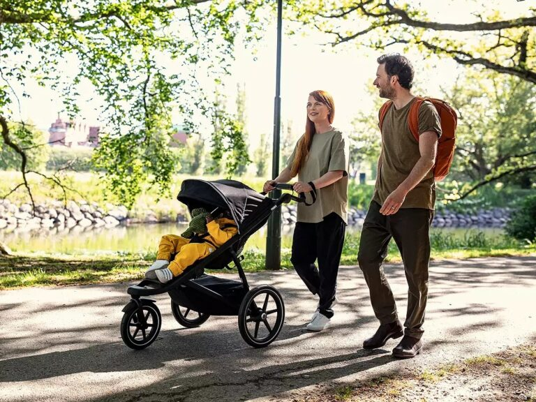 Couple out walking with baby in a stroller