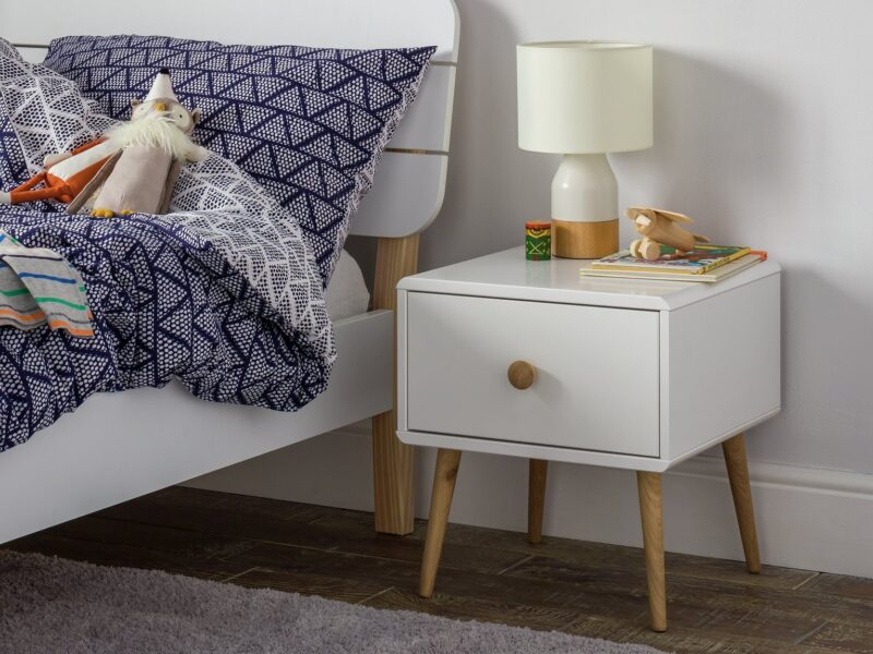 White bedside drawer with oak legs and handle