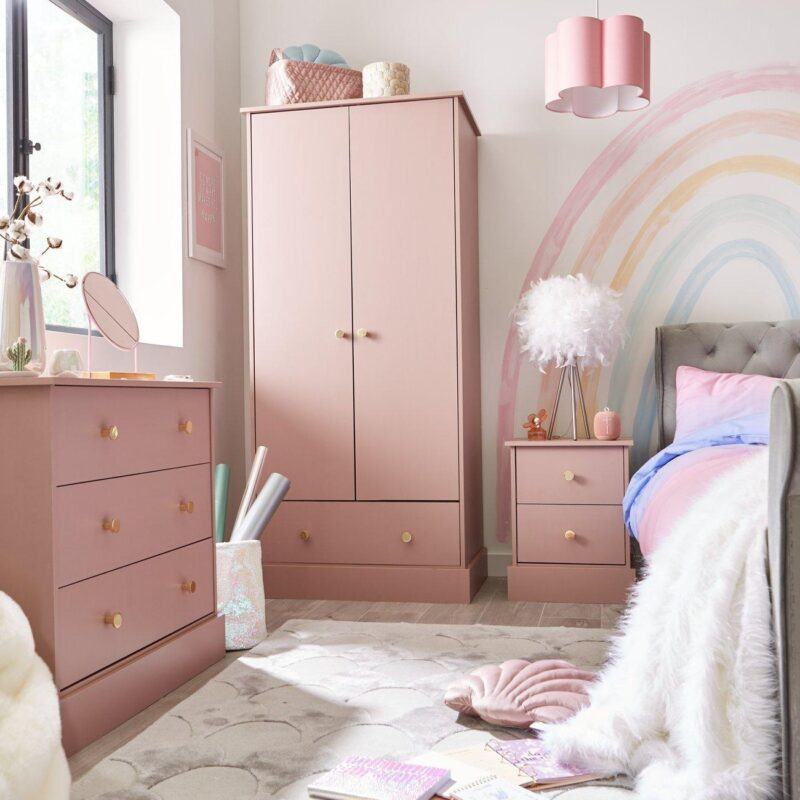 Pink bedroom furniture with round gold handles
