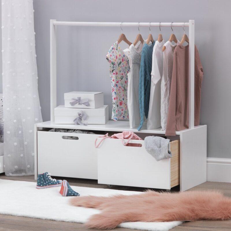 Low storage unit with clothes rail