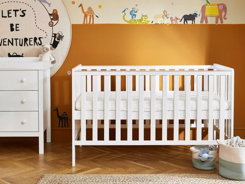 White-painted cot and matching dresser