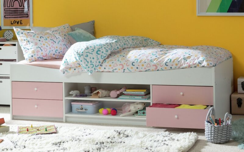Pink and white cabin bed